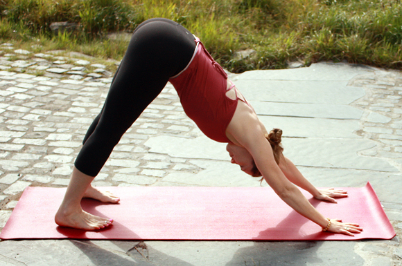uma kleppinger in downward facing dog pose